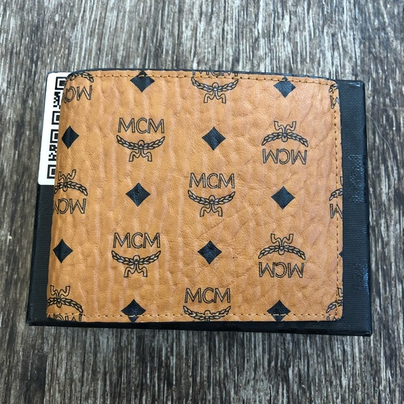 2cbfdb0953b3 MCM Accessories | Claus Bifold Wallet In Visetos | Poshmark